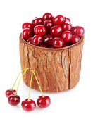 Sweet cherry in wooden basket isolated on white — Stock Photo