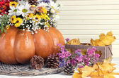 Beautiful autumn composition in pumpkin with bumps and decorative box on table on wooden background — Foto Stock