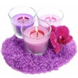 Beautiful colorful candles, orchid flower, sea salt isolated on white — Stock Photo