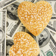 Stock Photo: Love and money concept. Heart-shaped stones and Americcurrency close up.