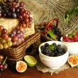 Assortment of juicy fruits and berries on wooden background — Stock Photo