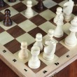 Chess board with chess pieces on wooden table close-up — Stock Photo #37851353