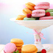 Gentle macaroons in vase on table on light background — Stock Photo