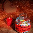 Dreams written on color rolled paper in glass jar, on sackcloth and fabric background — Stock Photo
