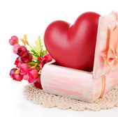Heart in wooden casket, isolated on white background — Stock Photo