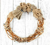 Beautiful rustic wreath, on wooden background — Stock Photo