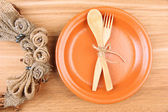 Rustic table setting with plate, fork and spoon, on wooden table — Stock Photo
