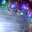 Christmas lights on wooden background — Stock Photo #37886085
