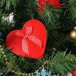 Heart - gift box on Christmas tree background, close-up — Stock Photo #37886149