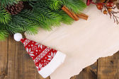 Christmas card on wooden background — Stok fotoğraf