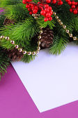 Christmas card on purple background — Photo