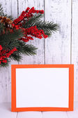 Christmas card on wooden background — Photo