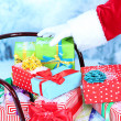 Sledge with Christmas presents, on winter background — Stock Photo