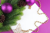 Christmas card on purple background — Stock Photo