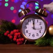 Wine glasses, retro alarm clock and Christmas decoration on bright background — Stock Photo #37925385