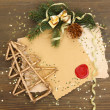 Photo: Frame with vintage paper and Christmas decorations on wooden background