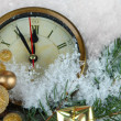 Clock with fir branches and Christmas decorations under snow close up — Stock Photo
