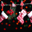 Christmas accessories on black background with lights — Stock Photo #37932603