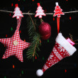 Santa hat and Christmas accessories on black background with lights — Stock Photo #37932607