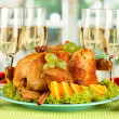 Banquet table with roast chicken and glasses of wine. Thanksgiving Day — Stock Photo #37939229