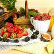 Assortment of juicy fruits and berries on wooden table, on light background — Stock Photo #37939659