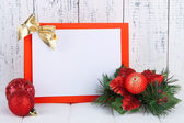 Christmas card on wooden background — Stock Photo