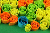 Colorful quilling on blue background close-up — Zdjęcie stockowe
