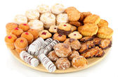 Sweet cookies on wooden plate isolated on whit — Stock Photo