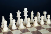 Chess board with chess pieces isolated on black — Stockfoto