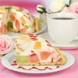 Stock Photo: Delicious jelly cake on table close-up