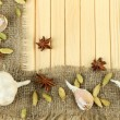 Stock Photo: Herbs and spices border, on wooden background