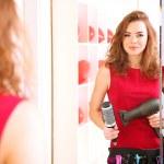 Beautiful girl hairdresser in beauty salon — Stock Photo
