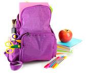 紫色のバックパックを白で隔離される学校供給 — ストック写真