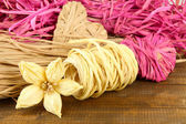 Decorative straw for hand made, heart and flower of straw, on wooden background — Stock Photo