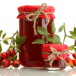 Jars with hip roses jam and ripe berries, isolated on white — Stock Photo #37955811