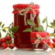 Jars with hip roses jam and ripe berries, isolated on white — Stock Photo