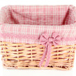 Wicket basket with pink fabric and bow, isolated on white — Stok Fotoğraf #37956247