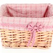 Wicket basket with pink fabric and bow, isolated on white — Stock Photo #37956247