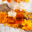 Medicine bottles and calendula flowers on wooden background — Stock Photo #37956481