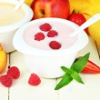 Delicious yogurt with fruit and berries on table close-up — Stock Photo #37956567