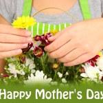Florist makes flowers bouquet in wicker basket — Stock Photo #37956651