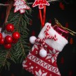 Santa sock and Christmas accessories on black background with lights — Stock Photo