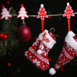 Santa sock, hat and Christmas accessories on black background with lights — Stock Photo