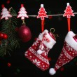 Santa sock, hat and Christmas accessories on black background with lights — Stock Photo #37957641