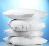Pillows, on blue background — Stock Photo