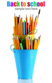 Colorful pencils and other art supplies in pails isolated on white — Stock Photo