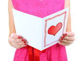 Young woman read Valentine card close up — Stock Photo