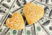 Love and money concept. Heart-shaped stones and American currency close up. — Stock Photo
