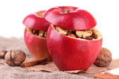 Stuffed apples with nuts and cinnamon on sackcloth close up — Stock Photo