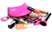 Scattered cosmetics isolated on white — Stock Photo